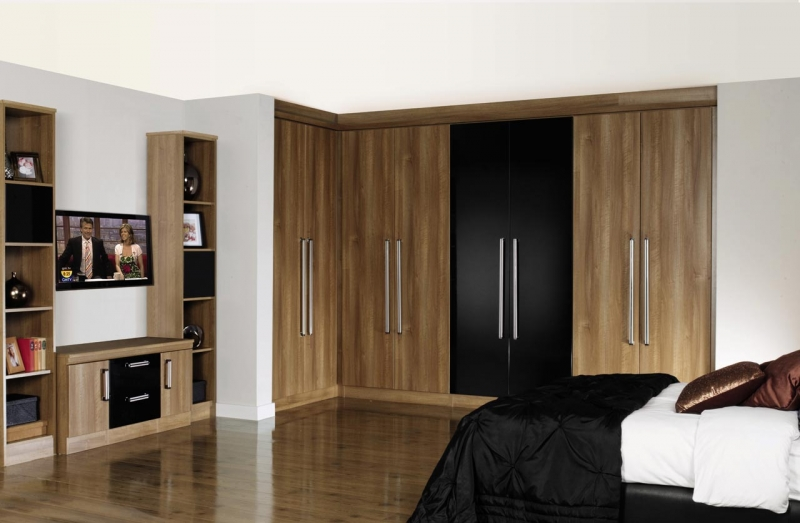 luxury-fitted-bedroom-design-with-brown-grains-wood-and-black-built-in-cup-board-and-bright-brown-tv-stand-mount-storage-plus-double-freestanding-shelves-also-black-duvet-plus